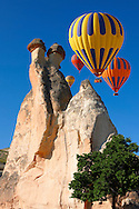 """Pictures & images of hot air balloons over the fairy chimney rock formations and rock pillars of """"Pasaba Valley"""" near Goreme, Cappadocia, Nevsehir, Turkey .<br /> <br /> If you prefer to buy from our ALAMY PHOTO LIBRARY  Collection visit : https://www.alamy.com/portfolio/paul-williams-funkystock/cappadociaturkey.html (TIP refine search - type which part of Cappadocia into the LOWER search box)<br /> <br /> Visit our TURKEY PHOTO COLLECTIONS for more photos to download or buy as wall art prints https://funkystock.photoshelter.com/gallery-collection/3f-Pictures-of-Turkey-Turkey-Photos-Images-Fotos/C0000U.hJWkZxAbg"""