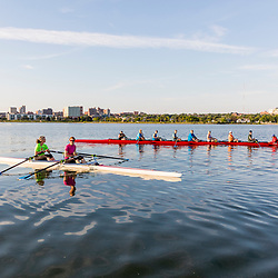 A morning rowing club (Portland Community Rowing Association) rows in Back Cove in Portland, Maine.