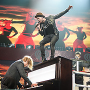 """WASHINGTON, DC - December 15th, 2014 - Brent Kutzle and Ryan Tedder of One Republic  perform onstage during HOT 99.5's Jingle Ball 2014 at the Verizon Center in Washington, D.C. Their hits include """"Counting Stars"""" and """"Good Life."""" (Photo By Kyle Gustafson / For The Washington Post)"""