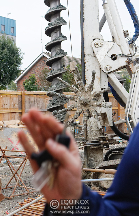 London, United Kingdom - 10 October 2015<br /> Huge drill cuts Virgin fiber cable. Thousand customers without weekend TV and internet. Severed fiber optic cables have caused up to a thousand customers of Virgin Media in Shoreditch and Hackney in London to be left without broadband internet and cable television this weekend. Engineers believe the total loss of service, which continues to be down this Saturday evening, is unlikely to be fixed until Sunday lunchtime at the earliest. The damage to a primary cable carrying 96 fiber optic cables including some belonging to the EE mobile network was caused by a huge drilling rig on a nearby construction site for a block of flats being built by Formation Construction Ltd. An engineer working on the drilling site claimed they had not 'drilled through the cable'. 'We damaged the cable' he said. He then demanded we delete images of the offending drilling rig. Technicians working on behalf of Virgin Media were working hard to replace the damaged cables. Virgin Media press office did not respond to repeated requests to speak with them for comment today.<br /> (photo by: EQUINOXFEATURES.COM)<br /> <br /> Picture Data:<br /> Photographer: Equinox Features<br /> Copyright: ©2015 Equinox Licensing Ltd. +448700 780000<br /> Contact: Equinox Features<br /> Date Taken: 20151010<br /> Time Taken: 17531843<br /> www.newspics.com