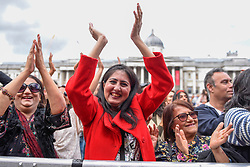 © Licensed to London News Pictures. 08/06/2019. LONDON, UK.  People celebrate the EID Festival in Trafalgar Square, an event hosted by The Mayor of London.  The Mayor's festival takes place in the square one week after the end of Ramadan and includes a variety of stage performances and cultural activities.  Photo credit: Stephen Chung/LNP
