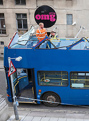 © Licensed to London News Pictures; 10/09/2020; Bristol, UK. Emergency services work to free a bus that crashed into a low bridge with a height of 13 foot six inches over Frogmore Street by the OMG nightclub in Bristol City Centre. No one was hurt. It is the second crash of a bus under a low bridge that has happened today, the first one being in Winchester where several children were seriously hurt. Photo credit: Simon Chapman/LNP.