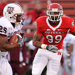 Oct 10, 2009; Piscataway, NJ, USA; Rutgers defensive end Jonathan Freeny (99) tracks Texas Southern running back Martin Gilbert (25) during second half NCAA college football action in Rutgers' 42-0 victory over Texas Southern at Rutgers Stadium.
