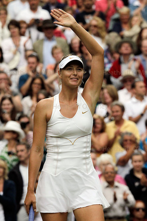 Mcc0032212 . Daily Telegraph..Maria Sharapova celebrates her victory over Sabine Lisicki in two straight sets on Centre Court in the Ladies Singles semi-finals...Maria Sharapova vs Sabine Lisicki..The Tenth day of The Lawn Tennis Championships at Wimbledon..London 30 June 2011