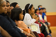 Avani Thakur cheers for remaining contestants during the 2016 Milpitas Youth Spelling Bee at the Milpitas Senior Center in Milpitas, California, on January 22, 2016. (Stan Olszewski/SOSKIphoto)