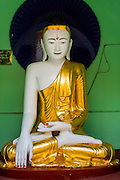 07 JUNE 2014 - YANGON, YANGON REGION, MYANMAR: A statue of the Buddha in Shwedagon Pagoda in Yangon, Myanmar. Shwedagon Pagoda is officially called Shwedagon Zedi Daw and is also known as the Great Dagon Pagoda and the Golden Pagoda. It's a 99 metres (325 ft) gilded pagoda and stupa located in Yangon. It is the most sacred Buddhist pagoda in Myanmar with relics of the past four Buddhas enshrined within: the staff of Kakusandha, the water filter of Koṇāgamana, a piece of the robe of Kassapa and eight strands of hair from Gautama, the historical Buddha.   PHOTO BY JACK KURTZ