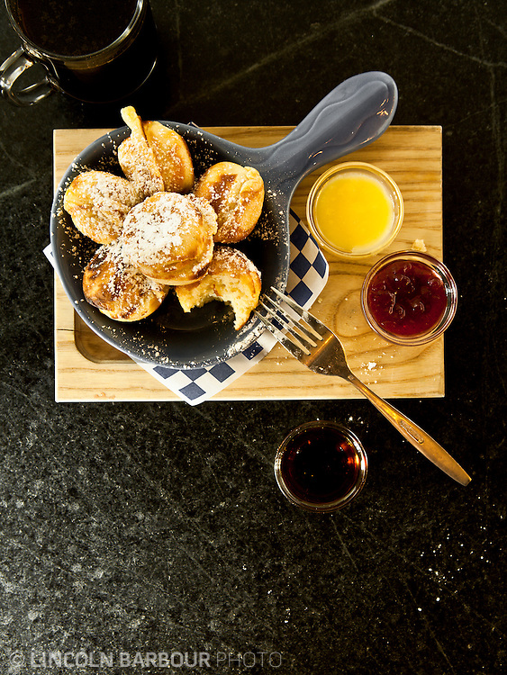 Overhead shot of Aebleskivers, a traditional Danish pancakes in a distinctive shape of a sphere. Kind of cross between a pancake and popover