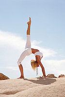 """Yoga One legged wheel pose.<br /> :::<br /> """"Stop acting so small. You are the universe in ecstatic motion.""""<br /> Rumi"""