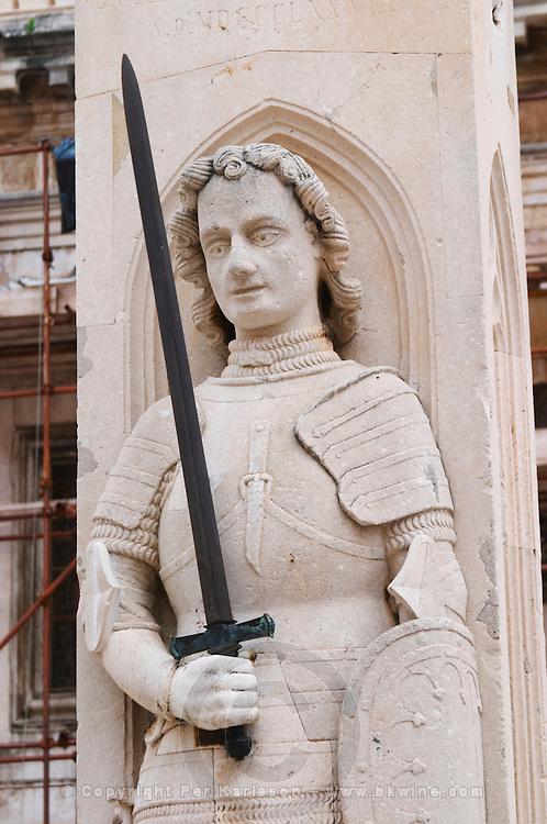 The Roland statue on the knight Orlando (Orlandov, Roland) column with his sword Durandal and armour on the Luza Lodge Loggia Square Dubrovnik, old city. Dalmatian Coast, Croatia, Europe.