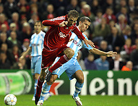 Photo: Paul Greenwood.<br />Liverpool v Marseille. UEFA Champions League, Group A. 03/10/2007.<br />Liverpool's Peter Crouch,left, tussles with Benoit Cheyrou for the ball