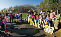 Renae Colby from GMI paving joined by Melissa Smith and Kristine Sweeney officially cuts the ribbon for the walking path at Pleasant Street School with Principal David Levesque and first grade students on Wednesday morning.  (Karen Bobotas/for the Laconia Daily Sun)