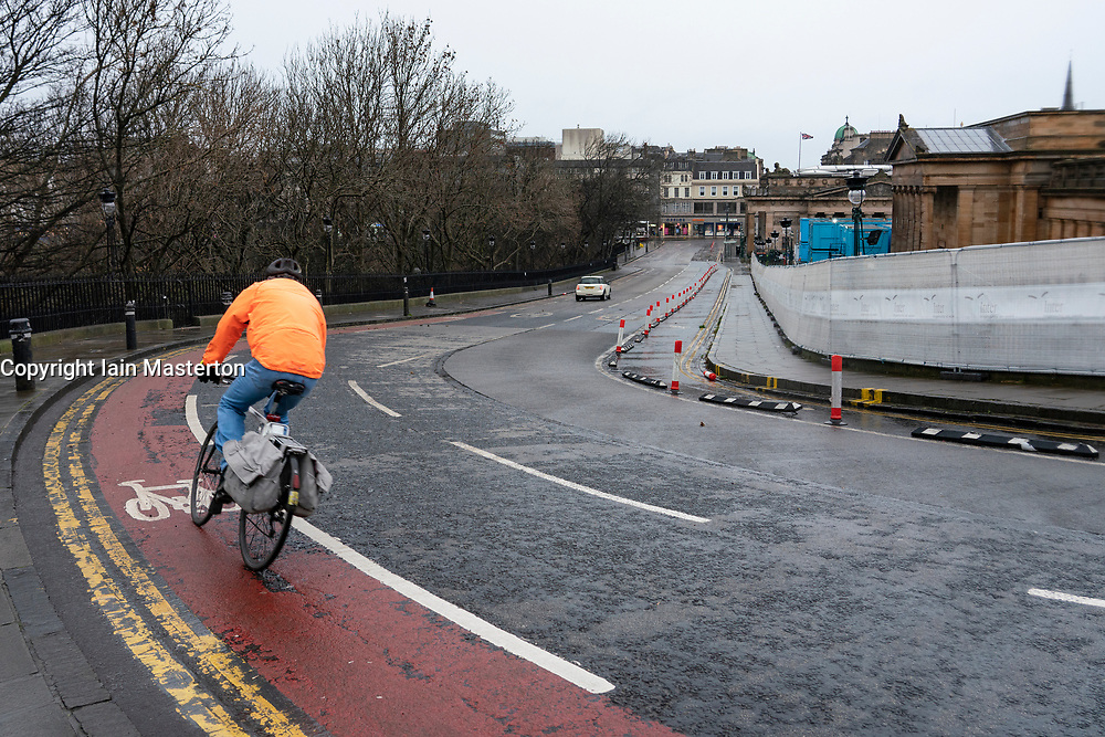 Edinburgh, Scotland, UK. 26 December 2020. Scenes from Edinburgh City Centre on a wet and windy Boxing Day during storm Bella. Today is first day that Scotland is under level 4 lockdown and all non essential shops and businesses are closed. As a result the streets are almost deserted with very few people venturing outside. Pic ; very little traffic on the Mound. ain Masterton/Alamy Live News