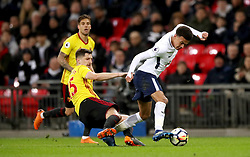 Watford's Craig Cathcart (centre) and Tottenham Hotspur's Dele Alli battle for the ball