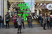 Shoppers on Oxford Street in central London with a sign advertising Black Friday in a shop window. This is the busiest shopping district in the capital with Oxford Street being the most crowded. Crowds can be so big that many people avoid the area altogether. There are 548 shops in Oxford Street; it is Europe's busiest shopping area.