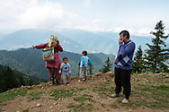 Yilmaz Civelek (right) and a farmer and her sons in the small village of Alaca Yaylası, high in the Pontic mountains on Turkey's green northern coastline. The farmers here communicate through 'bird language' whistling to each other across the vast mountains.