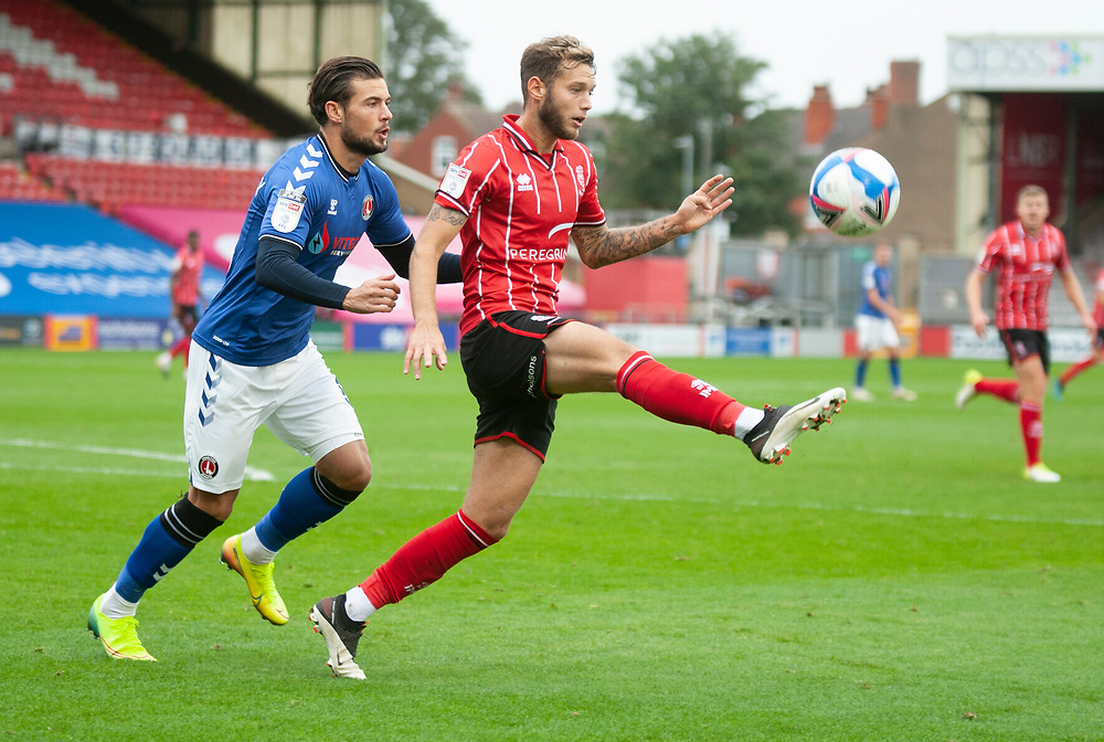 Lincoln City's Jorge Grant vies for possession with Charlton Athletic's Jake Forster-Caskey<br /> <br /> Photographer Andrew Vaughan/CameraSport<br /> <br /> The EFL Sky Bet League One - Lincoln City v Charlton Athletic - Sunday 27th September, 2020 - LNER Stadium - Lincoln<br /> <br /> World Copyright © 2020 CameraSport. All rights reserved. 43 Linden Ave. Countesthorpe. Leicester. England. LE8 5PG - Tel: +44 (0) 116 277 4147 - admin@camerasport.com - www.camerasport.com