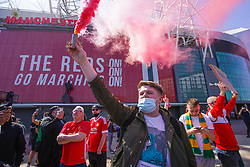 © Licensed to London News Pictures. 24/04/2021. Manchester, UK.  Manchester United fans protest against  Glazer family outside Old Trafford football stadium in Manchester this afternoon. Photo credit:  Ioannis Alexopoulos/LNP
