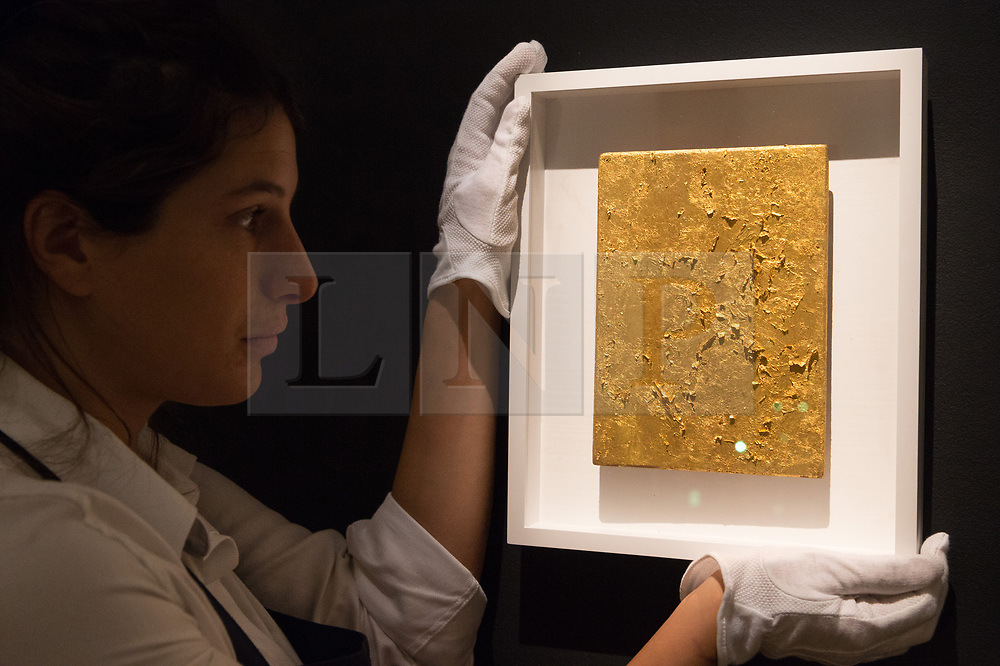 © Licensed to London News Pictures. 12/10/2018. London, UK. A gold leaf panel titled Monogold Sans Titre (MG 44) by artist Yves Klein with an estimate of £800,000 – 1,200,000 is on show as part of Sotheby's auction dedicated to all things gold. Photo credit: Ray Tang/LNP