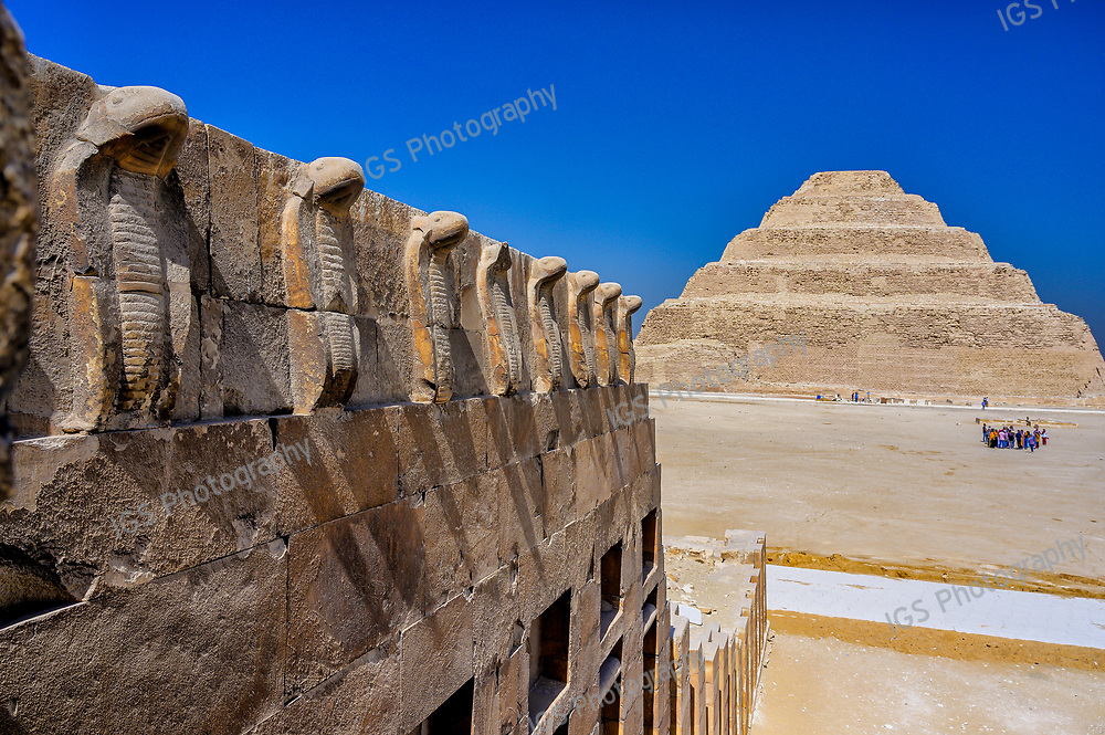 The frieze of cobras overlooking thr Great South Court and the Step Pyramid of Djoser