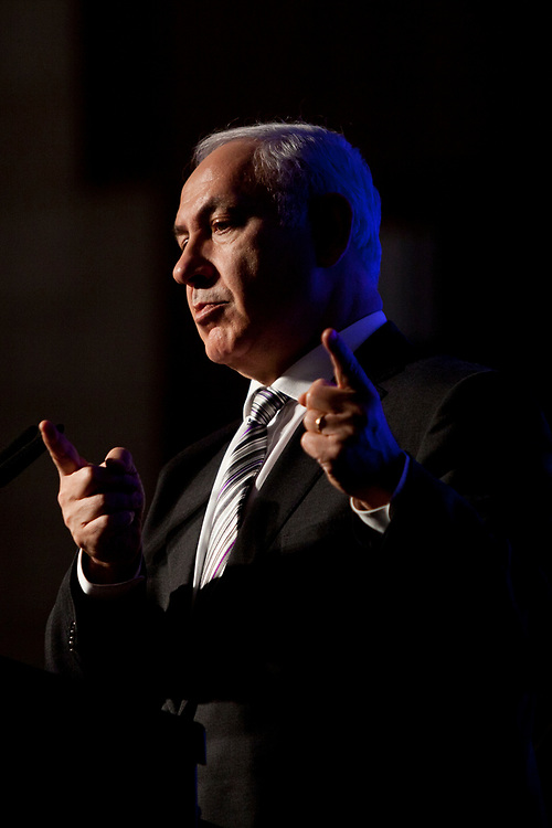 Israel's Prime Minister Benjamin Netanyahu gestures as he speaks during a reunion conference for the alumni of the National Security College in Jerusalem, on December 13, 2011.