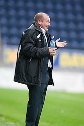Gus MacPherson, manager of Queen of the South smiles at the ref after letting a ball pass him and not putting it back in play..Falkirk 1 v 0 Queen of the South, 15/10/2011..Pic © Michael Schofield.