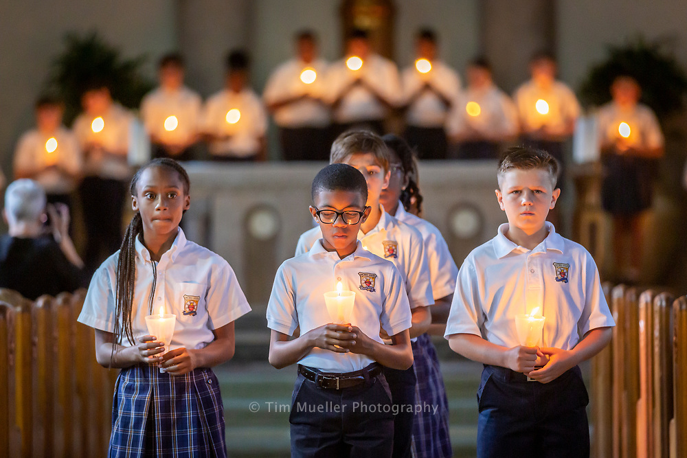 Sacred Heart of Jesus School students perform a Living Rosary at Sacred Heart of Jesus Church. October is dedicated as the Month of the Rosary to celebrate the memorial of Our Lady.
