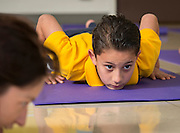 Students work out in a yoga class at Crockett Elementary School, September 23, 2014.