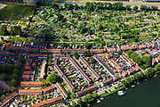 Nederland, Noord-Holland, Zaandam, 14-06-2012; volkstuinen en woonwijk tussen de Provinciale weg en de Oude Haven in de Zaan.<br /> Allotments and residential area in the city of Zaandam at the river Zaan.<br /> luchtfoto (toeslag), aerial photo (additional fee required)<br /> foto/photo Siebe Swart