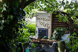 Sipson, UK. 5th June, 2018. A disabled toilet is pictured at Grow Heathrow. Grow Heathrow is a squatted off-grid eco-community garden founded in 2010 on a previously derelict site close to Heathrow airport to rally support against government plans for a third runway and it has since made a significant educational and spiritual contribution to life in the Heathrow villages, which remain threatened by Heathrow airport expansion.