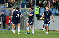 Scotland's Peter Horne (centre) celebrates during the NatWest 6 Nations match at the Stadio Olimpico, Rome.