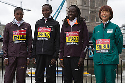 © Licensed to London News Pictures. 18/04/2013. London, England. L-R: Tiki Gelana, Priscah Jeptoo, Edna Kiplagat and Yoko Shibui. Virgin London Marathon - Photocall with International Women Runners Athletes Tiki Gelana (ETH), Edna Kiplagat (KEN), Priscah Jeptoo (KEN) and Yoko Shibui (JPN) at Tower Bridge ahead of Sunday's run, London. Photo credit: Bettina Strenske/LNP