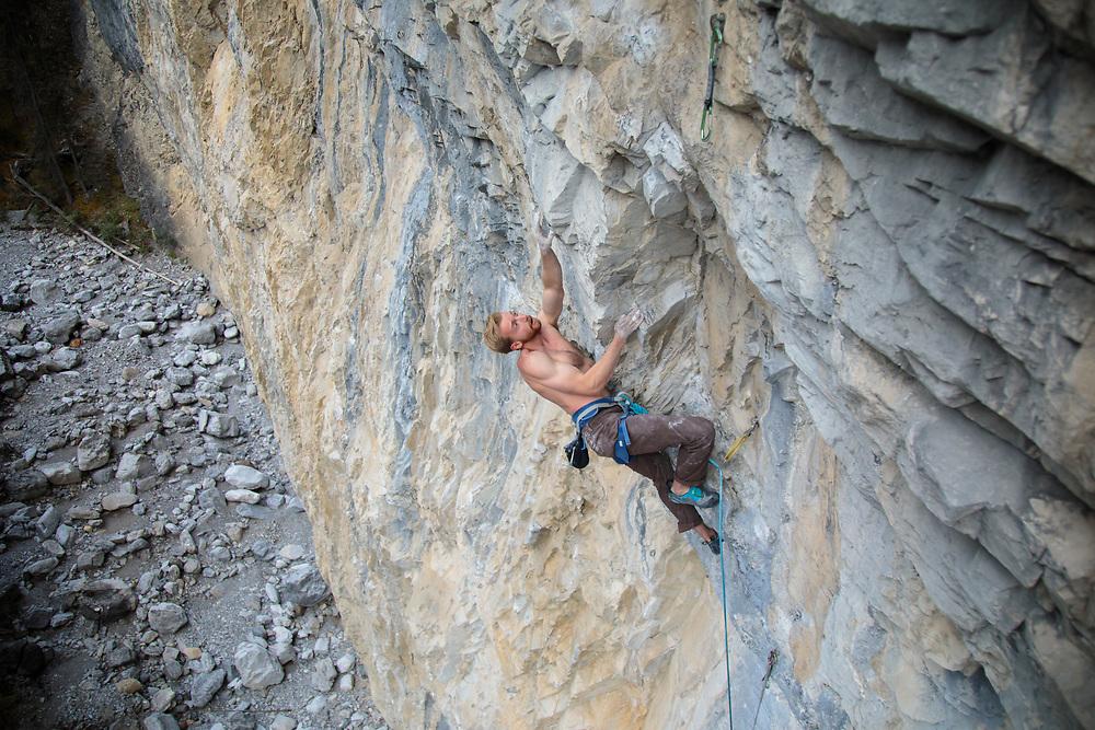 Nathan Hart climbing Shooting Packer, 5.13b at Planet X in Cougar Canyon