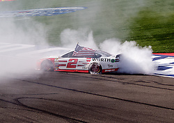 FONTANA, CA - MAR 22 NASCAR driver of the No. 2 Team Penske Brad Keselowski took away the win from Kurt Busch in the last lap (lap 209) in a dramatic Auto Club 400 ending with three red flags in the last three laps of the Auto Club 400 in Los Angeles, USA. 2015 Mar 22. Byline, credit, TV usage, web usage or linkback must read SILVEXPHOTO.COM. Failure to byline correctly will incur double the agreed fee. Tel: +1 714 504 6870.