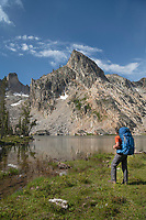 Adult male backpacker with blue pack at Twin Lakes on the Alice-Toxaway Lakes Loop Trail Sawtooth Mountains