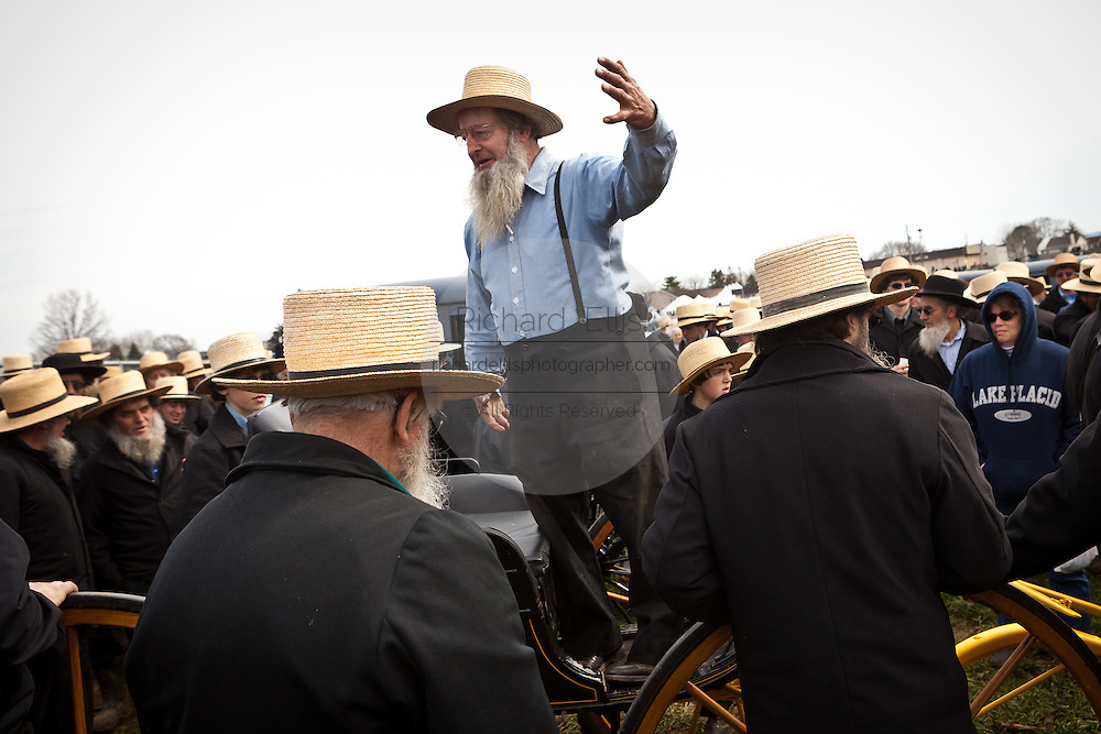 Amish men bid on horse buggies during the Annual Mud Sale to support the Fire Department  in Gordonville, PA.