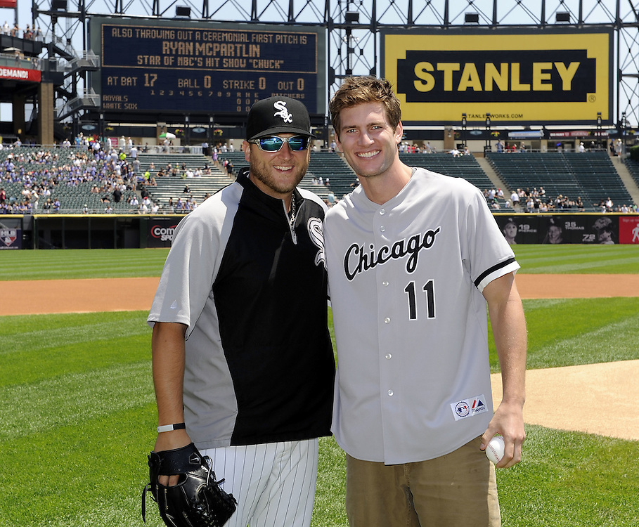 """CHICAGO - JULY 06:  Actor Ryan McPartlin, star of the television series """"Chuck"""", poses with White Sox pitcher Mark Buehrle #56 after throwing a ceremonial first pitch prior to the game between the Chicago White Sox and Kansas City Royals on July 6, 2011 at U.S. Cellular Field in Chicago, Illinois.  The Royals defeated the White Sox 4-1.  (Photo by Ron Vesely/MLB Photos via Getty Images)  *** Local Caption *** Ryan McPartlin;Mark Buehrle"""