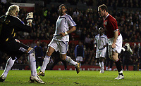 Photo: Paul Thomas.<br /> Manchester United v Europe XI. Friendly match. 13/03/2007.<br /> <br /> Wayne Rooney (R) scores.