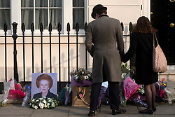 © Licensed to London News Pictures. 08/04/2013. London, UK. A Thatcher portrait and flowers left at the house where former Conservative Prime Minister Margaret Thatcher lived in central London. Lady Thatcher dies this mooring from a suspected stroke..Photo credit : Peter Kollanyi/LNP