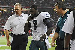 ATLANTA, GA - SEPTEMBER 18: Quarterback Michael Vick #7 of the Philadelphia Eagles walks off the field after getting injured during the game against the Atlanta Falcons at the Georgia Dome on September 18, 2011 in Atlanta, Georgia . (Photo by Drew Hallowell/Philadelphia Eagles/Getty Images) *** Local Caption ***  Michael Vick
