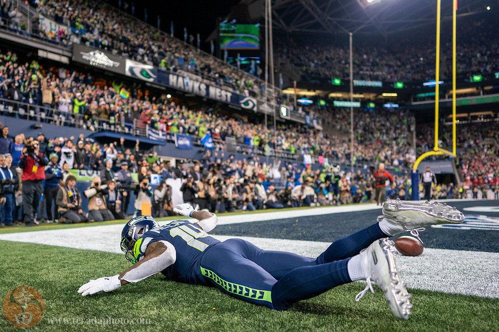 December 29, 2019; Seattle, Washington, USA; Seattle Seahawks wide receiver D.K. Metcalf (14) celebrates after scoring a touchdown during the fourth quarter against the San Francisco 49ers at CenturyLink Field.