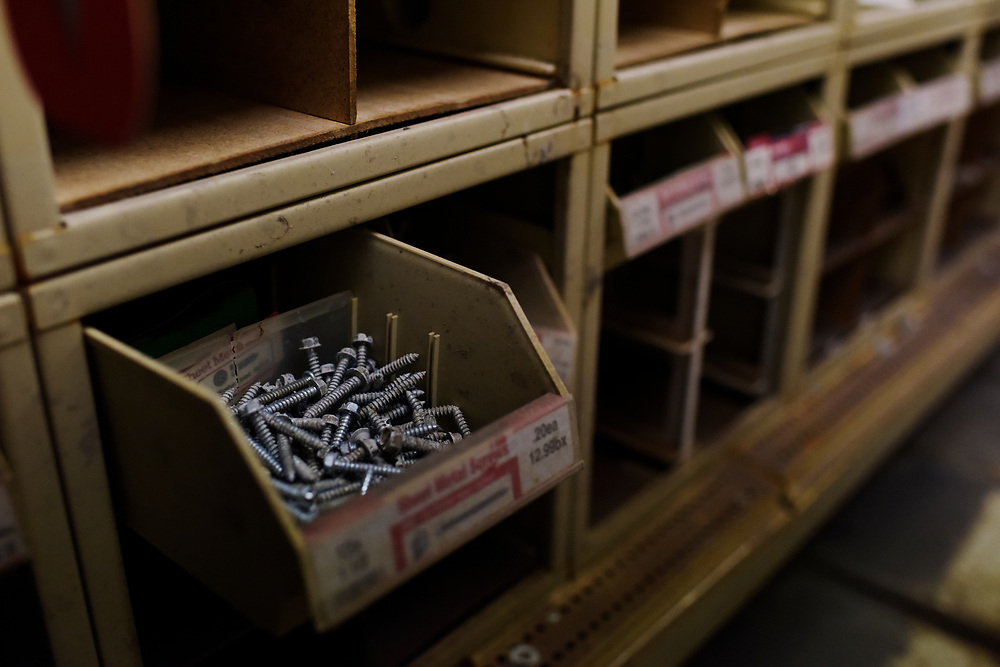 A small box of screws is seen amidst the mostly empty aisles of Snoddy's general store outside of Boonville.
