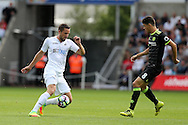 Gylfi Sigurdsson of Swansea city (l) looks to go past Oscar of Chelsea. Premier league match, Swansea city v Chelsea at the Liberty Stadium in Swansea, South Wales on Sunday 11th Sept 2016.<br /> pic by  Andrew Orchard, Andrew Orchard sports photography.