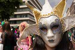 London, June 28th 2014. A masked participant stares inro the camera as the Pride London parade proceeds through the city's streets.