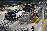 SAN LUIS POTOSI, MEXICO - JUNE 13, 2019: Cars on the conveyor belt in the assembly area at the BMW vehicles production plant in Mexico.