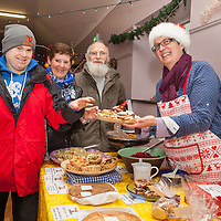 Brendan, Breda and Conrad McCullough taste some home made mince pie's from Shirley O'Connor of The Larder Deli at the Ballyvaughan Christmas Fair