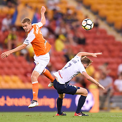 BRISBANE, AUSTRALIA - MARCH 31: Thomas Kristensen of the Roar and Andrew Hoole of the Mariners compete for the ball during the Round 25 Hyundai A-League match between Brisbane Roar and Central Coast Mariners on March 31, 2018 in Brisbane, Australia. (Photo by Patrick Kearney / Brisbane Roar FC)