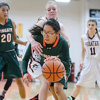 Wingate Bear Lynette Peshlakai (12) pushes past Grants Pirate Kaylee Morris (21) Tuesday at Grants High School.