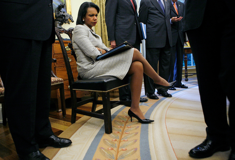 U.S. Secretary of State Condoleezza Rice sits in the Oval Office at the White House in Washington September 14, 2006. REUTERS/Jim Young
