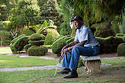 Pearl Fryar rests in his Topiary Garden August 21, 2013 in Bishopville, South Carolina. Pearl Fryar without any horticultural experience turned discarded plants into an amazing topiary wonderland in his former corn field in a tiny village in rural South Carolina.