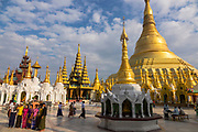 The Shwedagon Pagoda complex with tourists and monks. The complex is situated on Singuttara Hill in the center of Yangon (Rangoon), is the most sacred Buddhist stupa in Myanmar and one of the most important religious reliquary monuments in the world